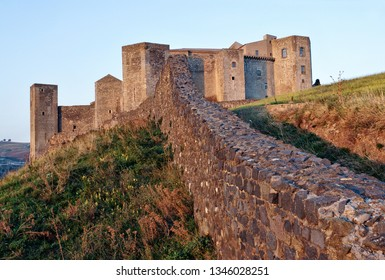 Melfi, district of Potenza, Basilicata, Italy - October, 07, 2004: the Norman-Swabian castle, in the foreground the walls of 1456-60 to defend the castle