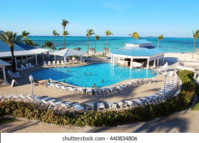 Melia Nassau Beach Resort, Bahamas - 10th of April, 2016: Several families enjoy their holidays in the swimming pool of this all-inclusive resort, placed close to a caribbean beach in Nassau.