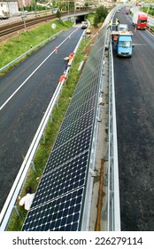 Melide, Switzerland - 3 May 2007: workers during the installation of solar panels near the highway at Melide on Switzerland