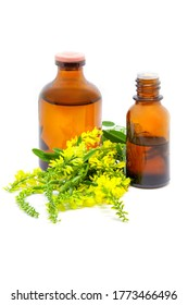 Melilotus officinalis, known as yellow sweet clover, yellow melilot, ribbed melilot, common melilot and pharmaceutical bottles on white background. Herbal medicine