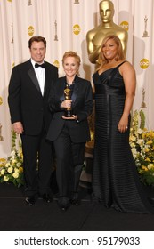 Melissa Etheridge with John Travolta & Queen Latifah at the 79th Annual Academy Awards at the Kodak Theatre, Hollywood. February 26, 2007  Los Angeles, CA Picture: Paul Smith / Featureflash