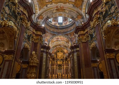 Melk. Austria. 08.05.16. High Altar in the church in Melk Abbey, a Baroque Benedictine Monastery at Melk in the Wachau Valley, Austria. The abbey was founded in 1089.