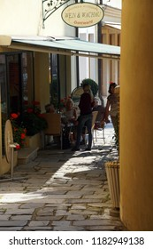 MELK, AUSTRIA - SEP 7, 2016 -  Tourists relax in a sidewalk cafe in   Melk, Austria