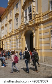 MELK, AUSTRIA - SEP 7, 2016 - Teenaged students leave the abbey school in  Melk, Austria