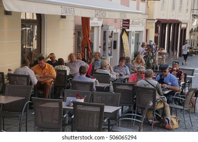 MELK, AUSTRIA - SEP 7, 2016 -  Tourists relax in a sidewalk cafe in   Melk, Austria