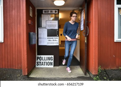 Melksham, UK - June 8, 2017: A voter leaves a polling station at a village hall. Polling stations have opened across the nation as voters decide UK's government in a general election.