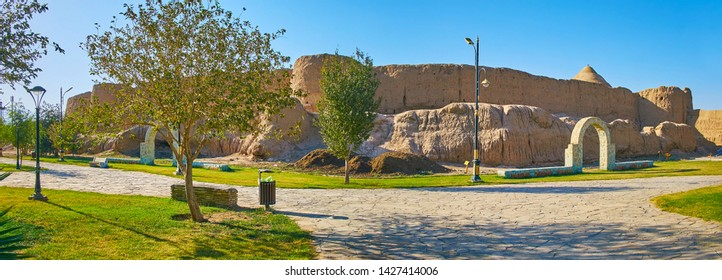 Mellat park is perfect place to relax in old town and observe preserved adobe walls of Ghal'eh Jalali fortress, Kashan, Iran
