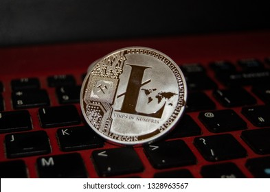 Mellieha, Malta 02.03.2019 - close up of lite coin on laptop keyboard phisical version of litecoin virtual currency