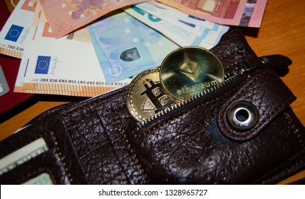Mellieha, Malta 02.03.2019 - ethereum and bitcoin phisical version of virtual currency in pocket of wallet stock market, buy and sell virtual currency