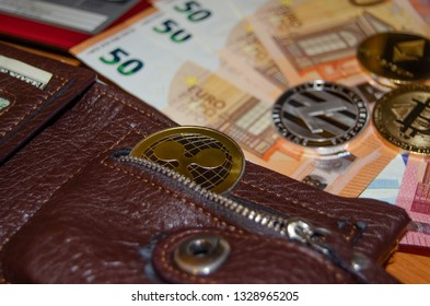 Mellieha, Malta 02.03.2019 - phisical version of diferent virtual currency over euro bank notes buy and sell virtual currency concept