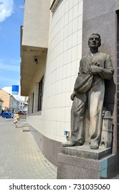 MELNIK, CZECH REPUBLIC - MAY 26, 2014: A sculpture of the sower at an entrance to the Czech savings bank