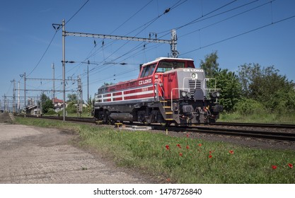 Melnik, Czech Republic - May 30, 2019: Red and grey diesel locomotive Cz loko 744 001 going on the track in direction Prague.
