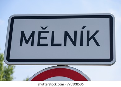 Melnik town entry sign on top of a traffic sign on sunny summer day in Melnik, Czech Republic