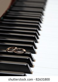 Melody of love: wedding rings on piano