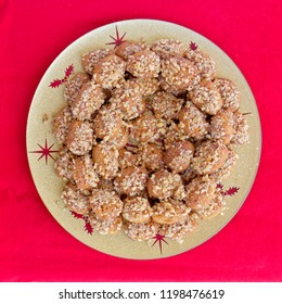 """""""melomacarona"""" traditional Greek Christmas cookies top view on red background"""