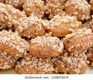 """""""melomakarona"""" traditional Greek Christmas cookies with honey syrup and nuts, top view"""