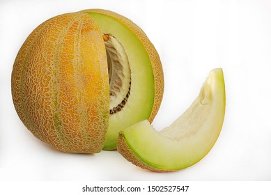 Melon cut with a separate piece on a white background