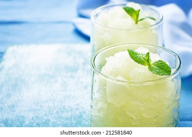 melon granita on light blue background. tinting. selective focus on mint