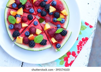 melon pizza with fresh fruits on the top, top view