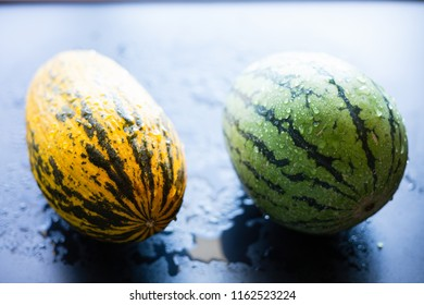 Melon and water melon on a black background, selective focus