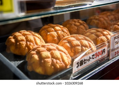 "Melonpan is a Japanese bun, A japanese bread is a dessert Melon Bread. selective focus with japanese language is ""Melon Pan 3 piece 500 yen"""