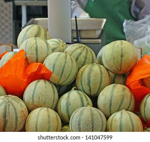 melons just picked up for sale by grocery store