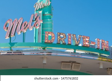 Mel's  Drive Diner sign sitting pretty on a bright blue sky day on March 24, 2019 in  Orlando Florida, United States in Universal Studios Theme Park