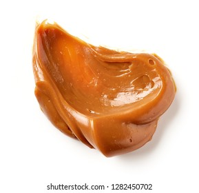 melted caramel isolated on a white background, top view