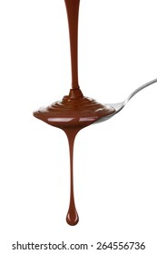 Melted chocolate poured into a spoon, isolated on the white background, clipping path included.