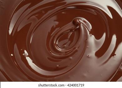 Melted chocolate swirl with a hazelnut/ melting chocolate/ chocolate swirl