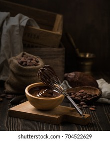 Melted chocolate in wooden bowl