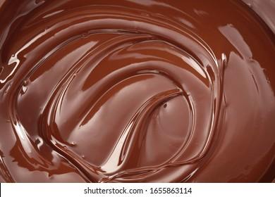 Arrière-plan tourbillon au chocolat noir fondu