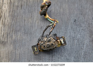 Melted-off and burned plastic socket of power supply.