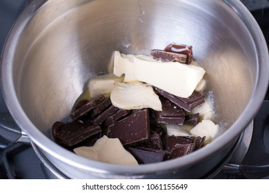 Melting chocolate and butter in a bain marie (in a bowl above boiling water).