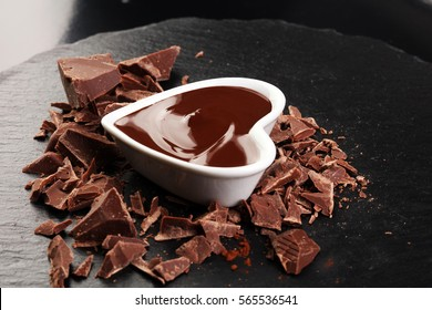 Melting chocolate / melted chocolate/ chocolate swirl/ stack/ chips and powder. Love concept. Valentine's Day Concept.