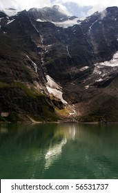 melting glacier with reflection in the lake with dark background