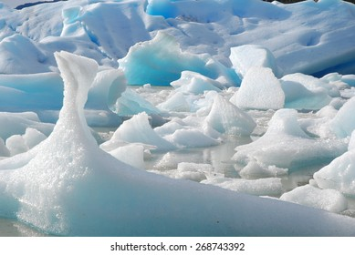 Melting ice breaking off of Grey Glacier in Torres del Paine National Park, Patagonia, Chile, South America.