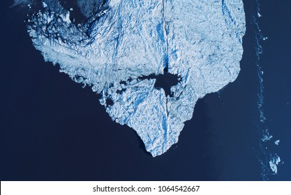Melting ice cap from above, drone photography perspective