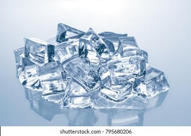 Melting ice cubes on blue background