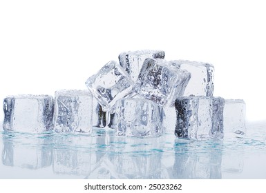 Melting ice cubes on a glass table