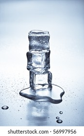 Melting ice cubes on a metal tabletop