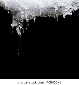 melting ice hanging from the roof. isolated on black