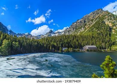 Melting ice on a surface of Popradske Lake in Popradske Pleso, Slovakia