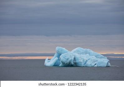 Melting iceberg in Arctic ocean