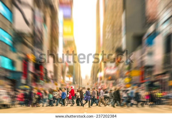 Melting pot people walking on zebra crossing and traffic jam on 7th avenue in Manhattan before sunset - Crowded streets of New York City during rush hour in urban business area