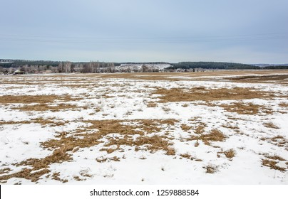 The melting of the snow on the fields in early spring