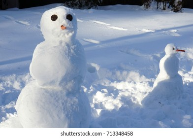 Melting Snowmen with Carrot Noses