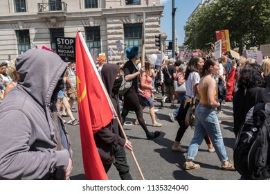 A member of Antifa marches down Whitehall during the Donald Trump protests in London. London, UK, 07/13/18