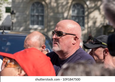 A member of the FLA (Football Lads Alliance) listens to protesters screaming insults at the Day for Freedom event in Whitehall, London.  06/05/18