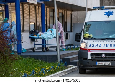 A member of the health staff team loading a coronavirus patient in an ambulance in Belgrade, Serbia on the date of April 7, 2020